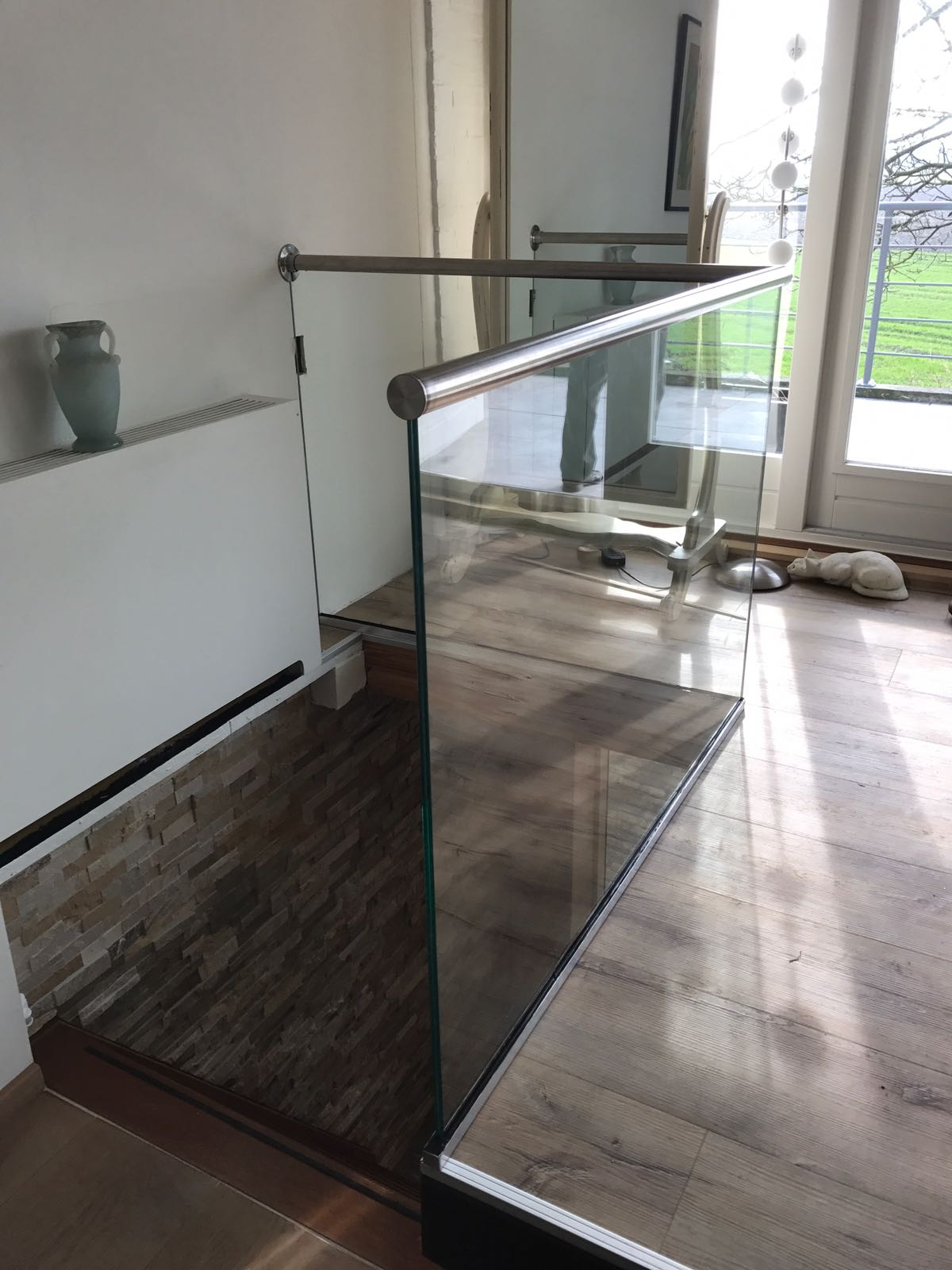 Balustrade met glas en RVS handregel